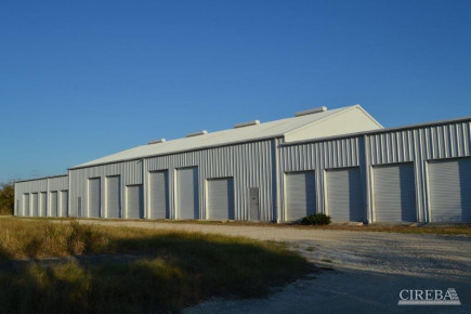 LITTLE CAYMAN WAREHOUSE (20 UNITS) AND LAND SUB-DIVISION  13 LOTS